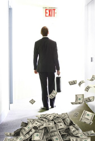 businessman walking away from money